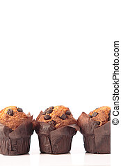 Three chocolate muffins isolated on a white background with copyspace. Vertical format.