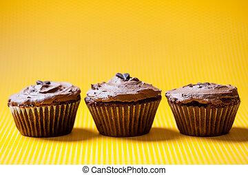 three chocolate velvet cupcakes with dark chocolate icecream