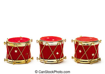 three christmas ball ornaments in drum shape on white background