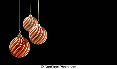 Three christmas balls hanging on ribbon on black background....