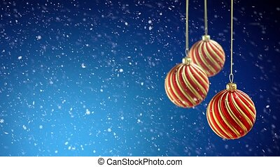 Three christmas balls hanging on ribbon on blue snow...
