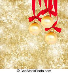 three christmas balls on golden background