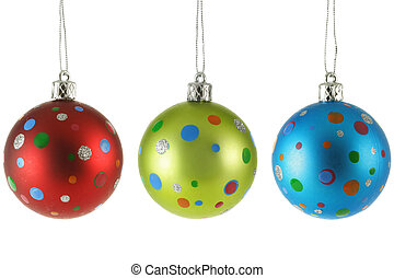 Three Christmas balls with colorful spots