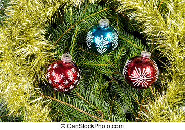 Three Christmas balls with gold chain
