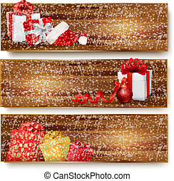 Three christmas banners with gift boxes and santa hat. Vector illustration