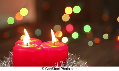 Three Christmas candles. blow out the fire