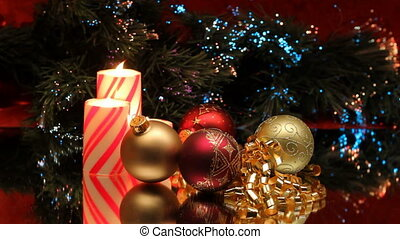 Three Christmas candles with ornaments