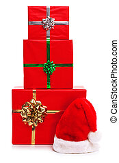 Three Christmas presents and Santa Claus hat.