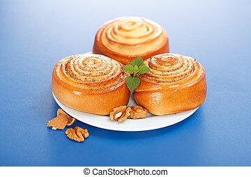 Three cinnamon rolls on plate