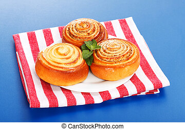 Three cinnamon rolls on white plate