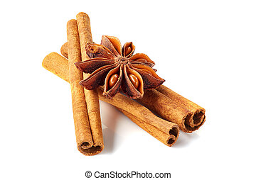 Three cinnamon sticks and star anise on white