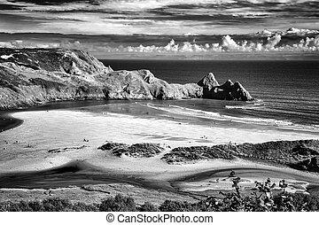 Three Cliffs Bay beach on the Gower Peninsular West Glamorgan Wales UK, which is a popular Welsh coastline travel destination