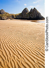 Three cliffs bay in Gower, Wales, UK in tide time