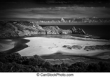 Three Cliffs Bay on the Gower Peninsular West Glamorgan Wales UK which is a popular Welsh coastline attraction