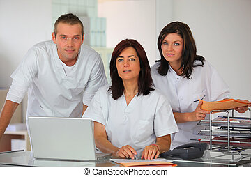 Three clinic workers