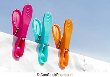Three clothes pegs on a line