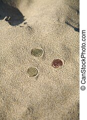 three coins at the beach