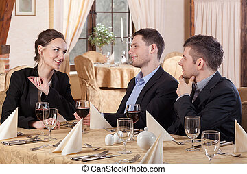 Three colleagues sitting in restaurant