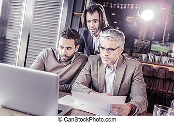 Three colleagues working together at business plan