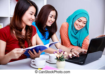 three college students look happy when studying together