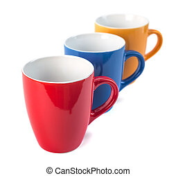 Three color ceramic cups on a white background