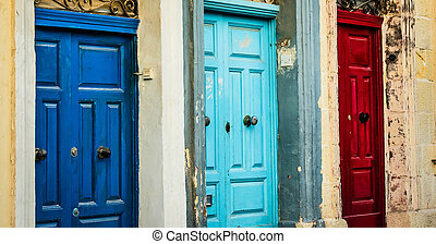 three color doors in a street of Valletta