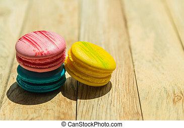 Three color of Macaroon on wooden floor 2