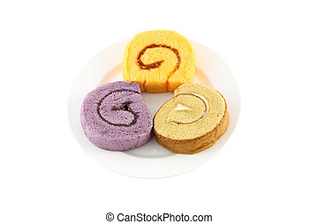 Three color sweet roll cake on dish.