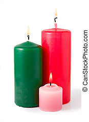 Three colored burning candles. Isolated on white