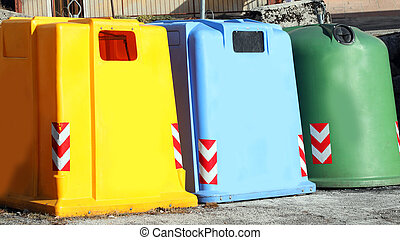 three colored dumpster to collect glass used paper and plastic