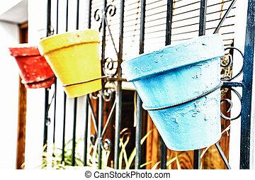 Three colored flowerpots