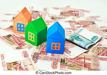 Three colored house on a background of Russian money