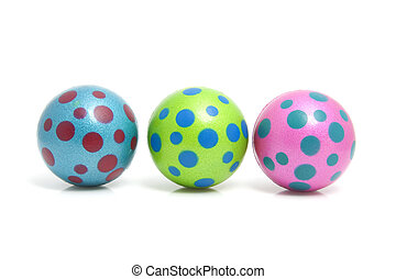 Three colorful dotted balls over white background