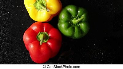 Three colorful fresh peppers - From above view of three...