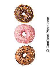 Three colorful glazed donuts isolated on white background, top view