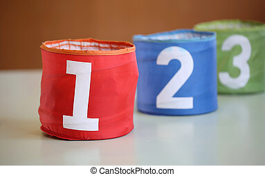three colorful jars in a school