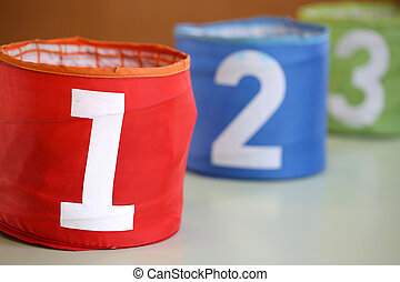 colorful jars in a school and the red jar with 1 written