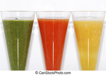 three different colorful refreshing healthy smoothie drinks partial view