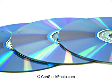 three compact disks - Three compact disks in a row