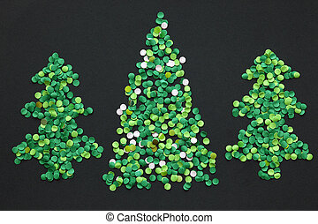 Three confetti christmas tree on a dark background