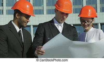 Three confident engineer