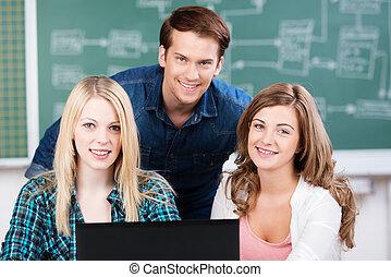 Three confident happy teenage college students