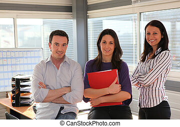 Three confident office workers