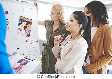 Three creative business women over work