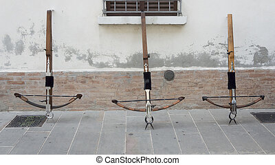 Three crossbows on the wall