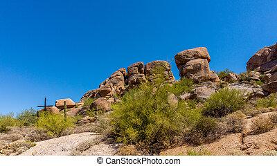 Three Crosses on a Desert Hillside