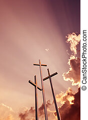 Three crosses over bright dramatic sky vertical image