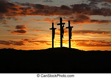 Three crosses over bright sunset with copy space - Three ...