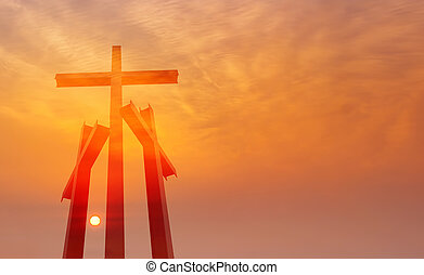 Three crosses over sunset background