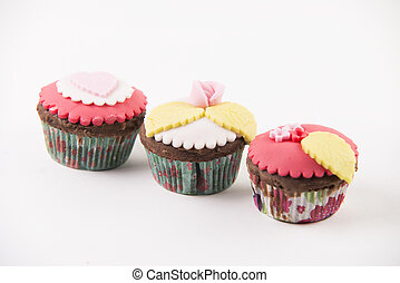 Three cupcakes isolated on white background